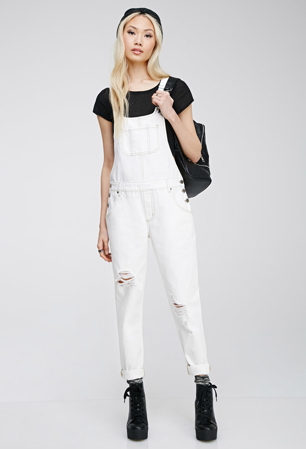 Overalls Are Making A Comeback As The Latest Fashion Trend: White Denim Overalls