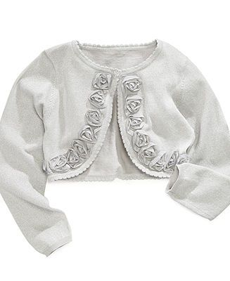 Very pretty girls cardigan sweater from Cherokee in girls size XL It features an open, draped front with roll-up sleeves. It is a light, fine gauge white cotton/rayon knit with silver edging.